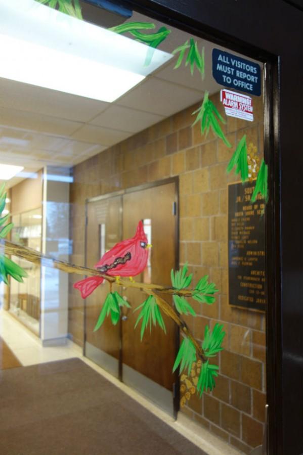 Ms.+Graham+%26+her+art+students+decorate+South+Shore+High+School+doors.