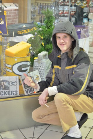 Samuel Bunker advertises Green Bay Packer merchandise.