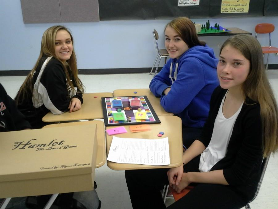 Seniors Kellie Rock, Casey Nicoletti & Alyssa Kavajecz proudly show off their countless hours of effort dedicated to creating a project of their choice after reading Shakespeare's Hamlet.