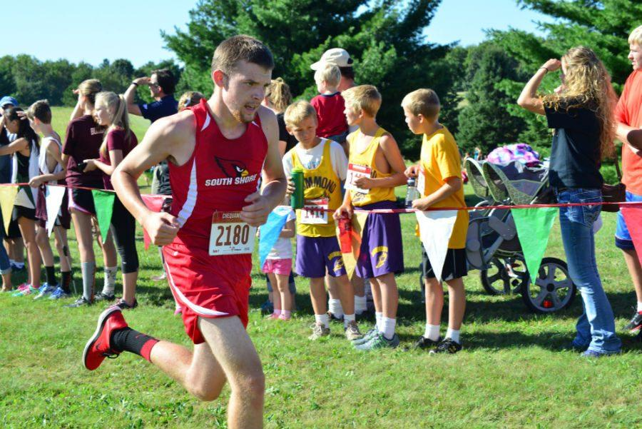 Hunter Schierman, a junior, finishes his race strong at the meet in Bruce.