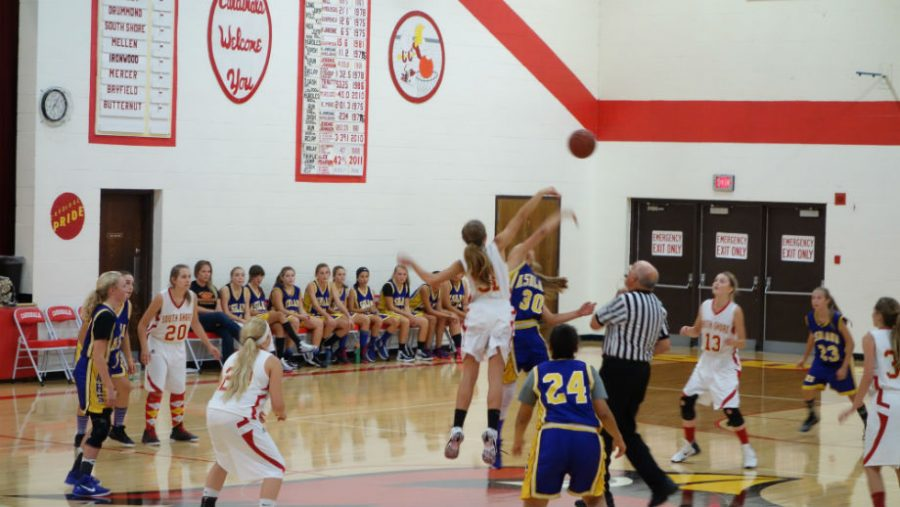 Chloe Sipsas, 8th grade, starts the game off by winning the jump ball.