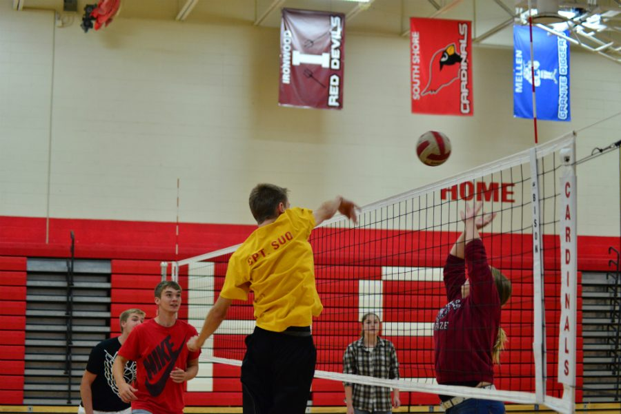 At one of the many practice match-ups, Hayden Suo goes up for the spike against the girls team.