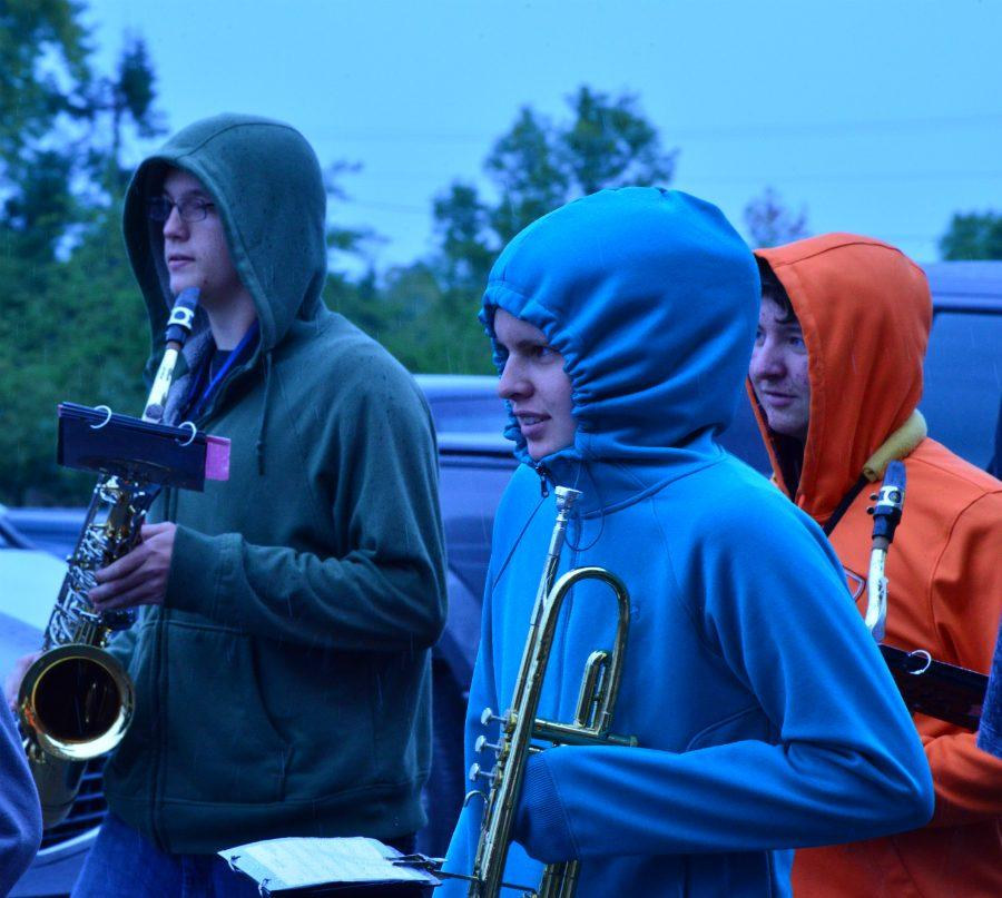 Band+practicing+outside+in+the+rain+for+Apple+Fest.++%28Kenneth+Botosh%2C+Shauna+Kavajecz%2C+and+Brendan+Golly%29