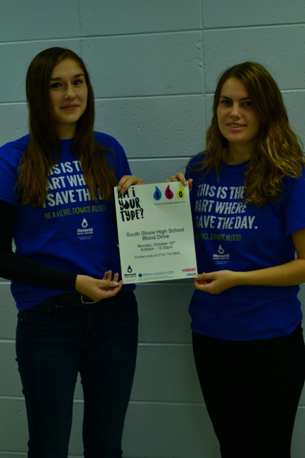 Emma+and+Rachael%2C+who+are+part+of+NHS%2C+hold+the+flyer+for+the+blood+drive.%0ANot+Pictured%3A+Hayden+Suo+%26+Roger+Branham