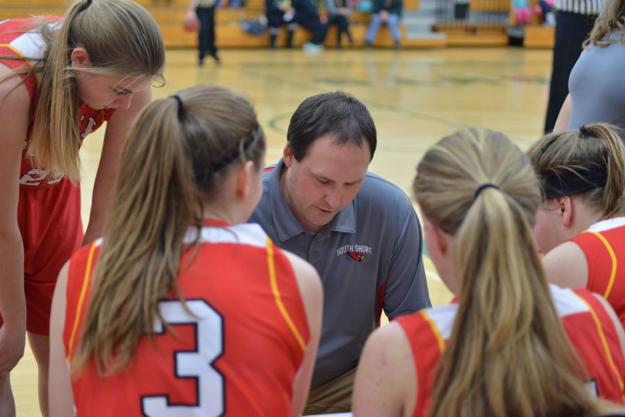 Head Coach Ryan Tiberg, explaining to the girls how to run the play during their next possession.