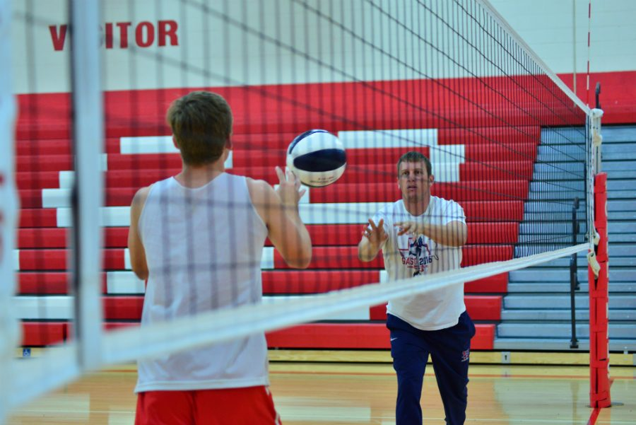 Connor Sorenson, a junior, and Coach Bailey work out in preparation for the season.