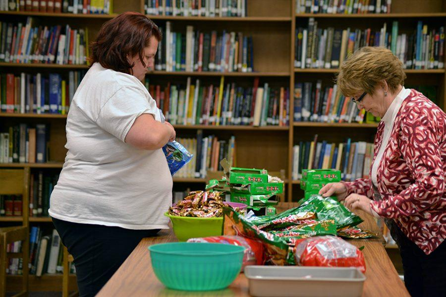 Melinda Laakkonen and Diana Reijo prep the gift bags to hand out at the annual Christmas concert.