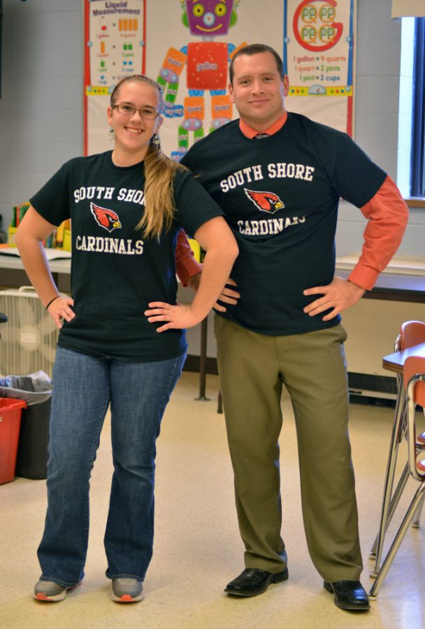Mr.+Nelson%2C+the+sophomore+class+advisor+%26+Elizabeth+Kobie+model+the+t-shirts+available+for+sale.