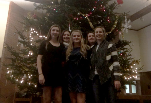 Standing before the giant tree in the Haas Fine Arts center on the UW-Eau Claire campus, the students on the choir trip get a small glimpse at the beautiful campus decorations.  Pictured: Natalie Knaack, Nicole Kavajecz, Lillian Tapini, Signe Branham, & Alyssa Kobie