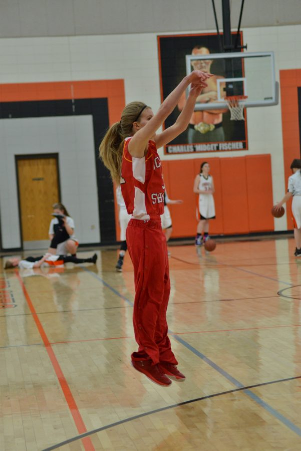Shauna Kavajecz hits the three in warm-ups against Butternut.
