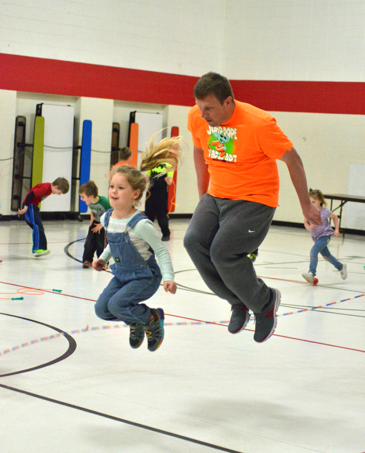 Jumping for a great cause, Mr. Bailey joins kindergartner Rocklynn Dull at the long rope.