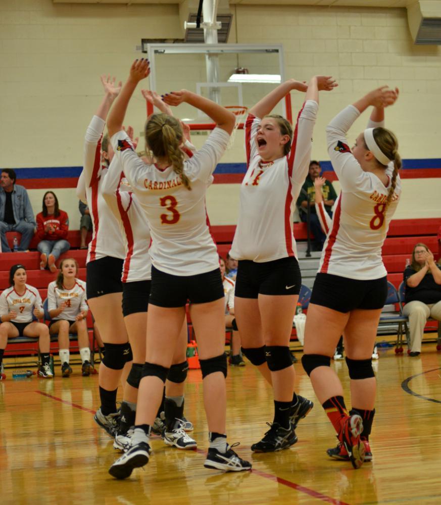 Varsity teammates Rylee Nicoletti, Morgan Rock, Heather Ranta, Myla Lahti, and Aurora Grant cheer after a block.