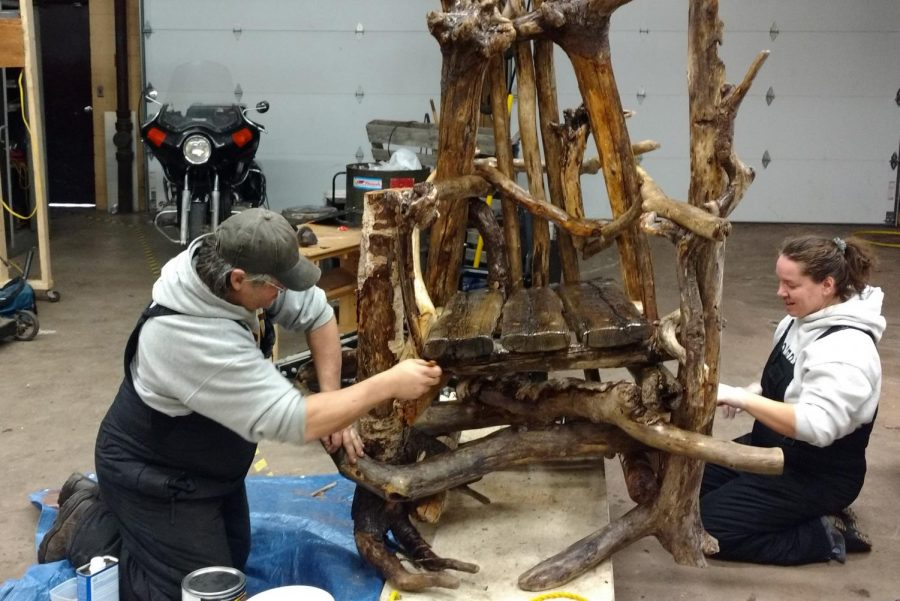 Bill & Peggy Golly prepare the chair for the outdoors