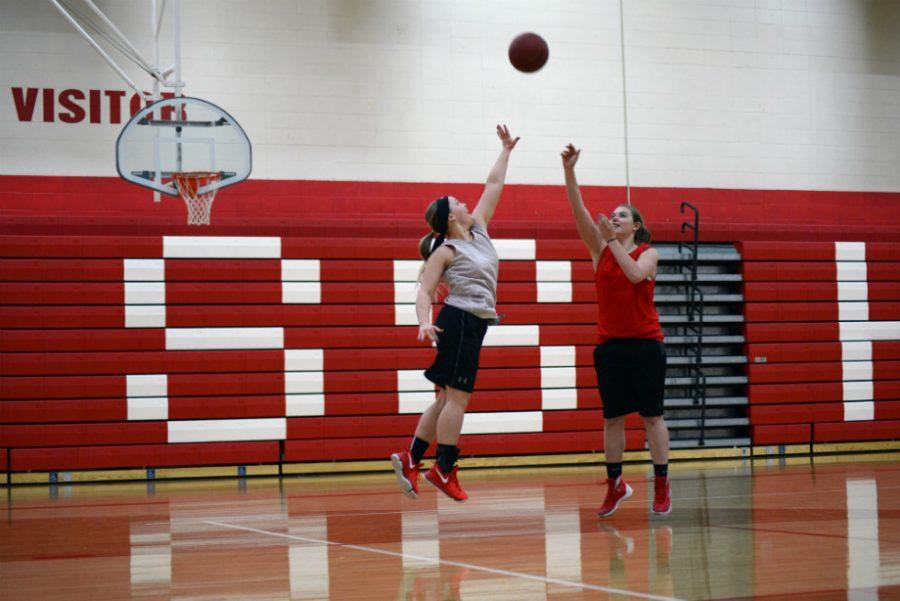 Morgan Rock & Heather Ranta in basketball practice.