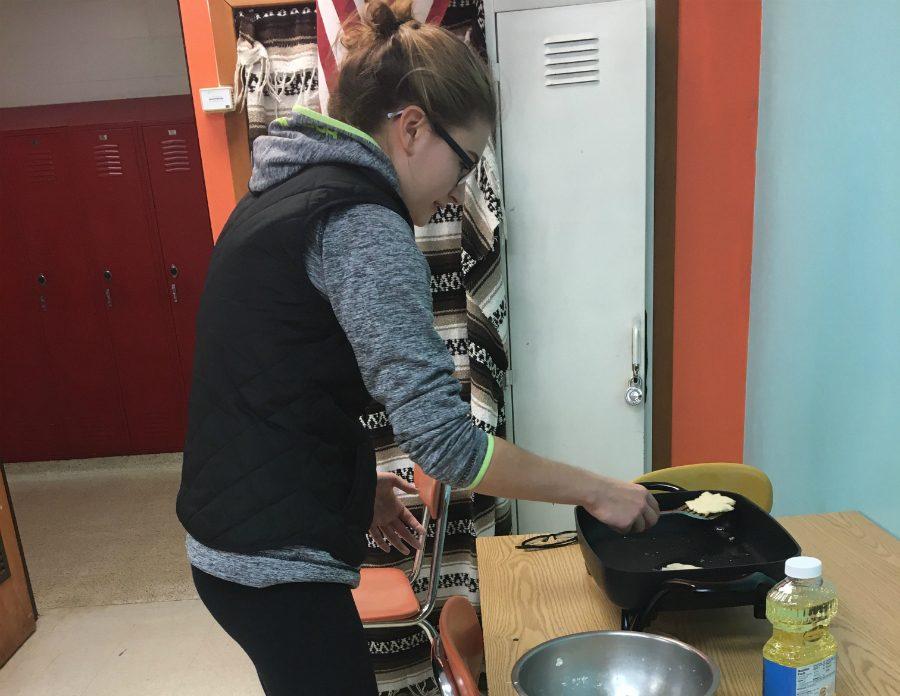 Rylee+Nicoletti%2C+a+Spanish+II+student%2C+prepares+the+traditional+Spanish+dish%2C+Arepas.+