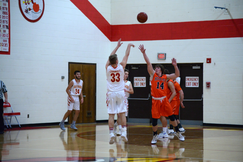 Dallas Williams, a senior, splashes a three right in front of a Hurley defender.