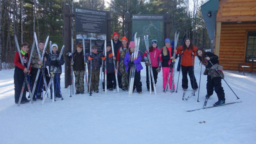 Peyton+Jardine%2C+Gavin+Matke%2C+Jed+Nabak%2C+Hunter+Mieritz%2C+Ian+Laakkonen%2C+Carter+Ray%2C+Mr.+Tiberg%2C+Gracelyn+Lovejoy%2C+Kiley+Mueller%2C+Faith+Whitmore-Langley%2C+Paige+Lahti%2C+Sarena+Kobie+%26+Savannah+Warren+all+pose+after+skiing+for+a+group+picture.