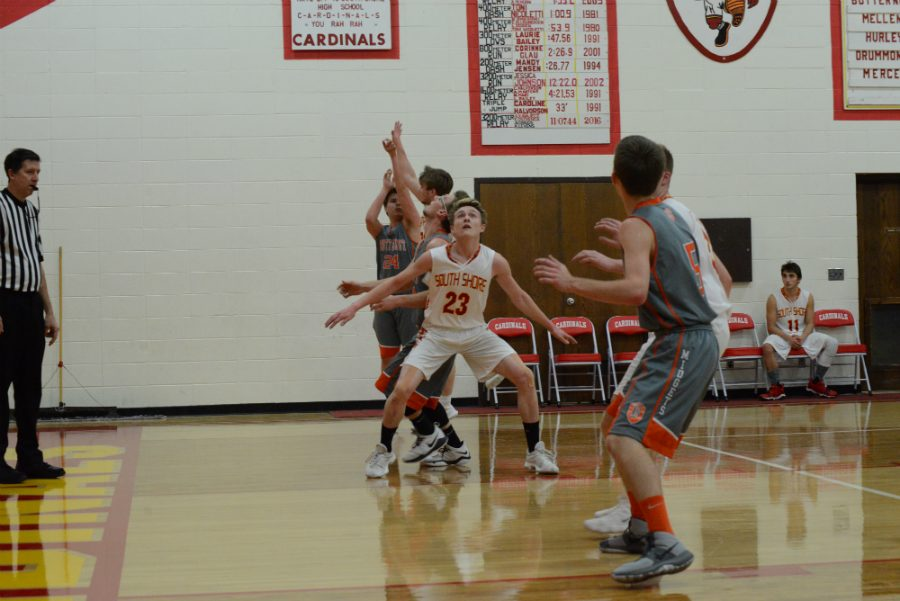 Tristin Wilcox boxes out a Midget to get the rebound.