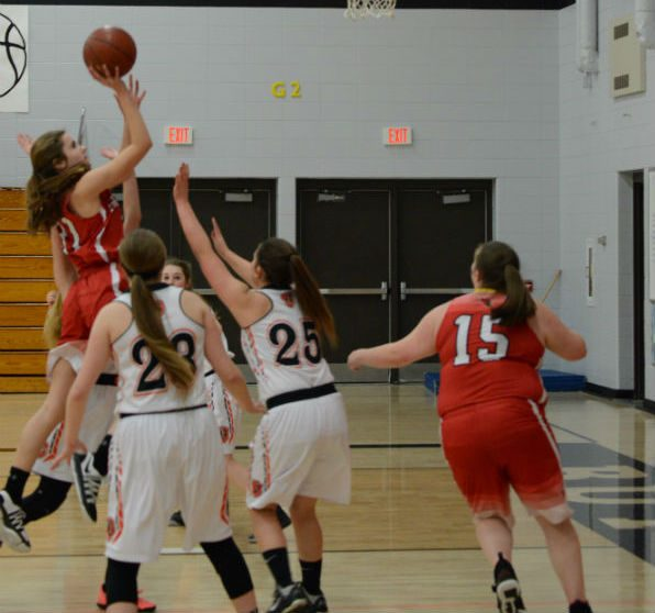 Freshman Chloe Sipsas rises above the Butternut defense for a shot as senior Signe Branham gets ready to rebound.