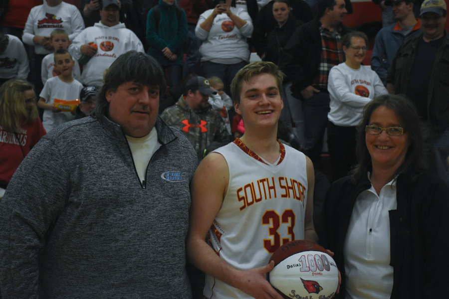Chris Williams, Dallas Williams & Tabby Gustafson with Dallas'1,000 point ball after the game against Drummond on Feb. 13, 2018.