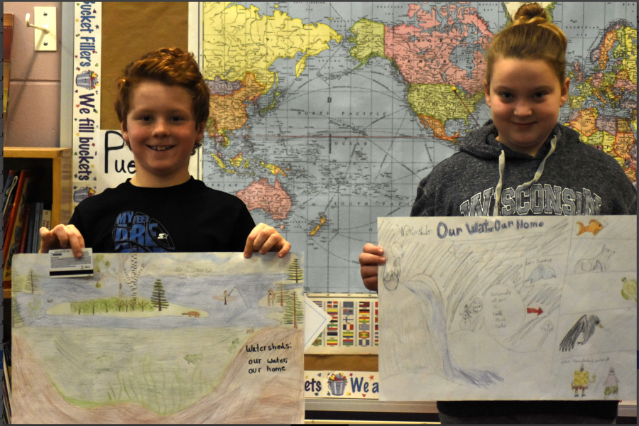Hayden Mieritz & Lillian Nollet proudly display their winning posters.