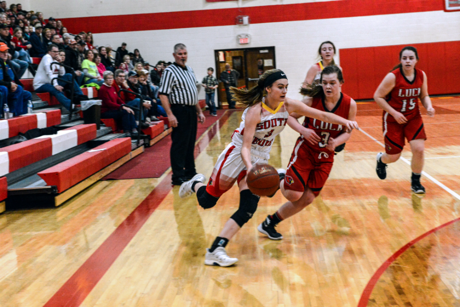 Rylee Nicoletti, a junior, drives on Luck defender.