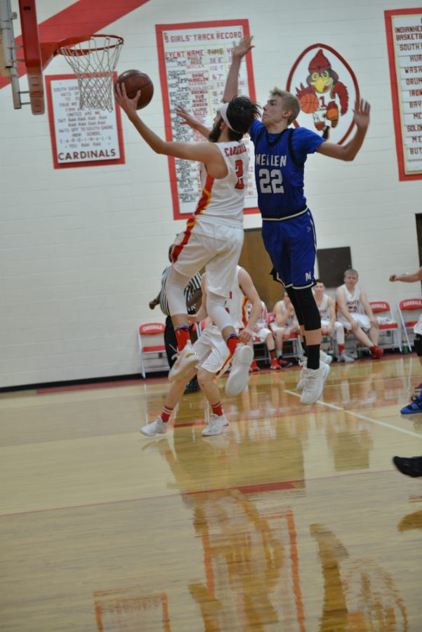 Bjorn Branham (2) goes up for the layup against Blaze Smith's (22) lacking defense.