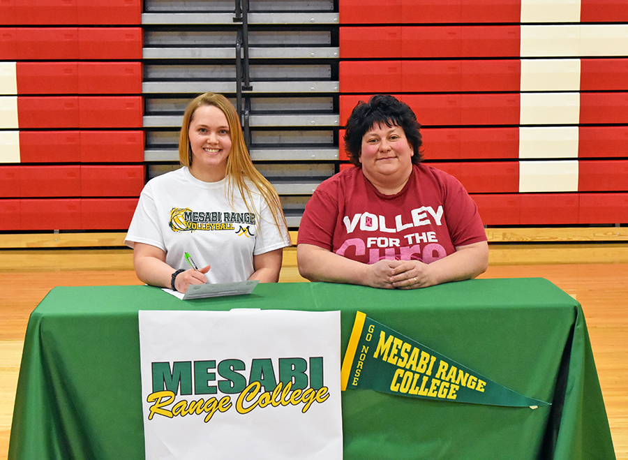 Morgan Rock signs her letter of intent next to her varsity coach, Darla Lahti.