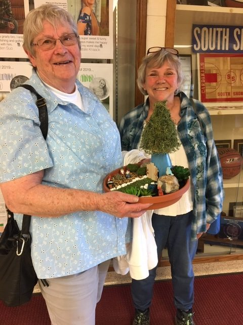 Dorthy Spiller & her friend pose with her completed fairy garden!